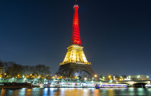 Eiffel Tower lit up in the colours of the Belgian flag.