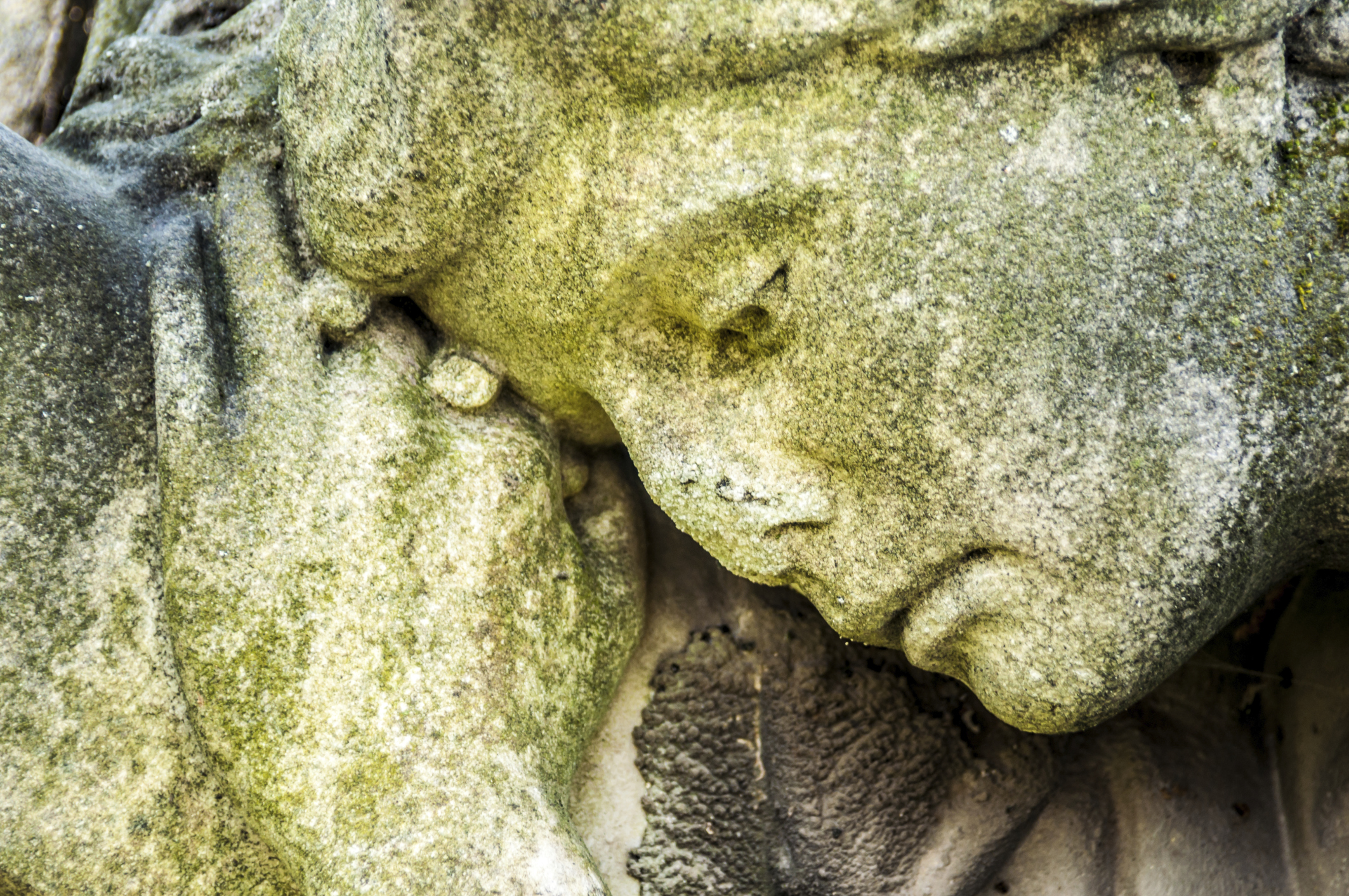 Sad stone figure in a graveyard