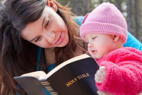 Mother and child reading the Bible